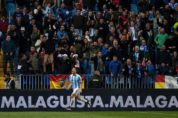 Malaga's Brazilian forward Charles Dias de Oliveira celebrates