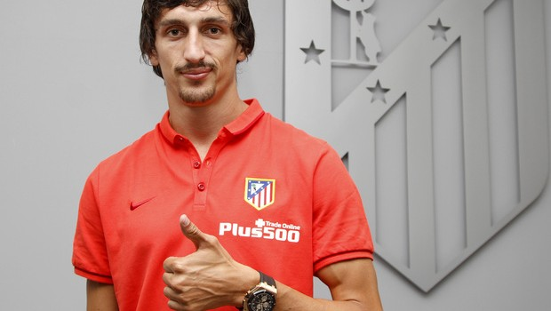Savic poses with his new crest for the first time
