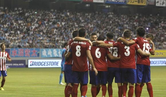 Players celebrate Koke's stunning Olympic goal