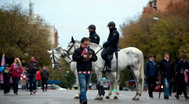Police patrol the area prior to a home game at the Calderón