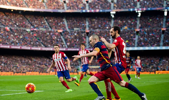 Juanfran wrestles with Iniesta at the Camp Nou earlier this season