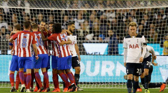 Players celebrate Godín's opening goal