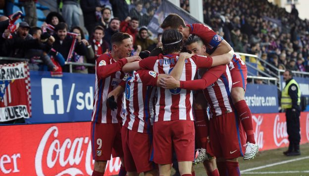 Players celebrate Saúl's (fortunate) opening goal