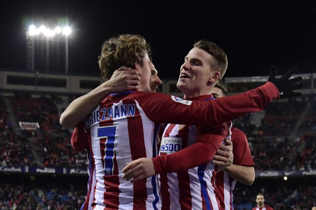 Griezmann and Gameiro celebrate the third goal