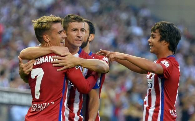 Griezmann celebrates after scoring a free-kick