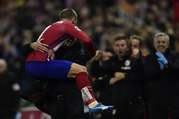 Griezmann leaps on Simeone after scoring the winner versus Athletic