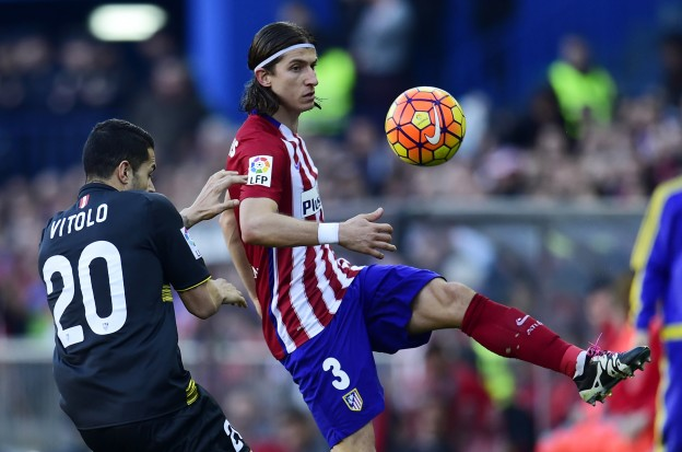 Filipe battles for the ball with Vitolo, who was sent off for Sevilla