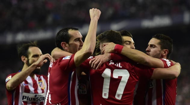 The players celebrate Saúl's equaliser