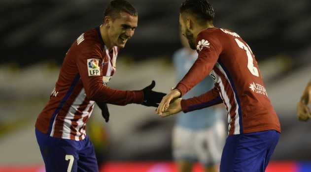 Carrasco celebrates his goal with Griezmann