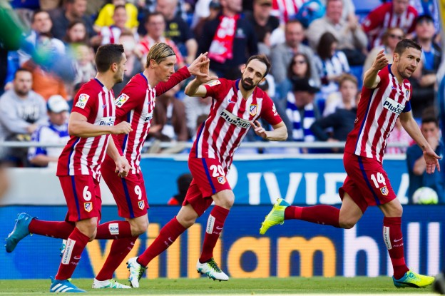 Torres celebrates scoring with Koke and Juanfran
