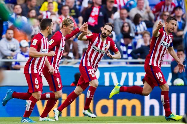 Torres celebrates scoring with Koke and Juanfran