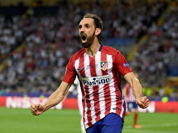 Juanfran, Atlético's right-back, celebrates Carrasco's goal at the San Siro