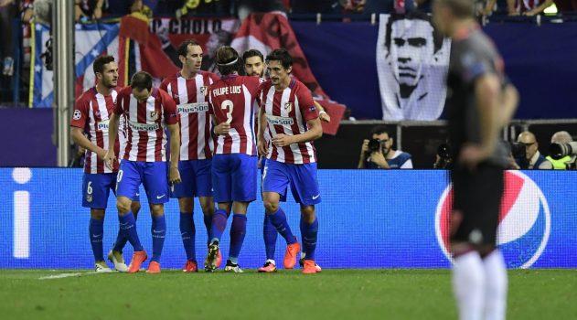 The team celebrates Carrasco's goal